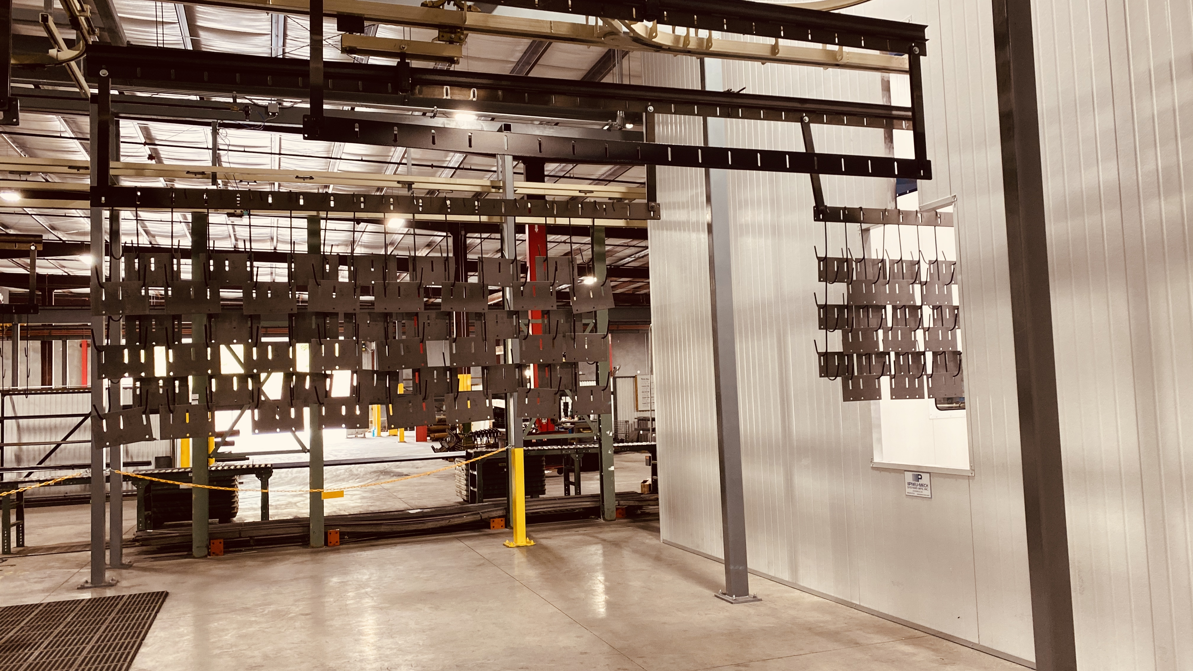 Overhead Door Components going through Powder Coating Assembly Line