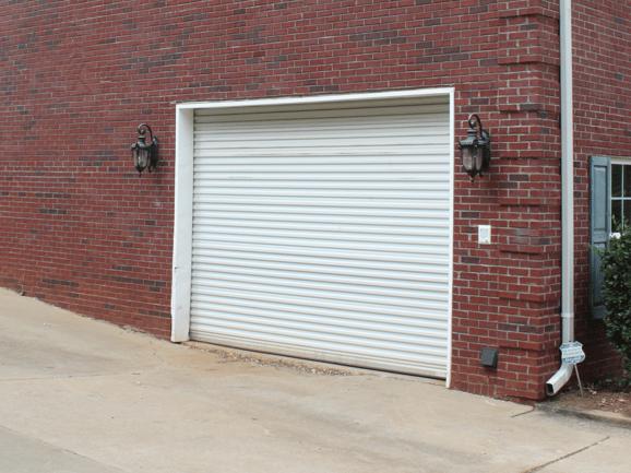 white roll up door model 1000 on garage