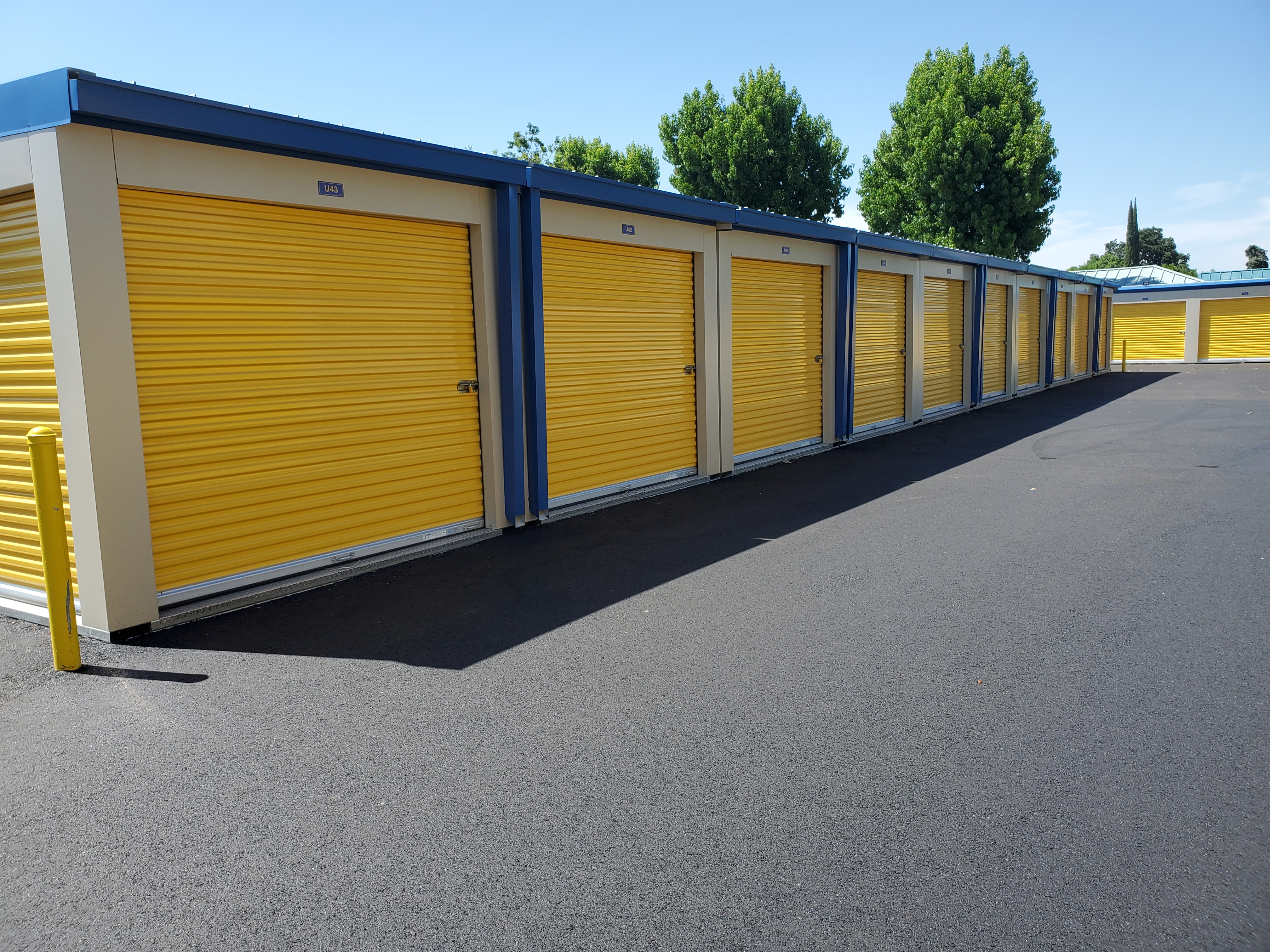 Yellow and blue MASS relocatable storage units