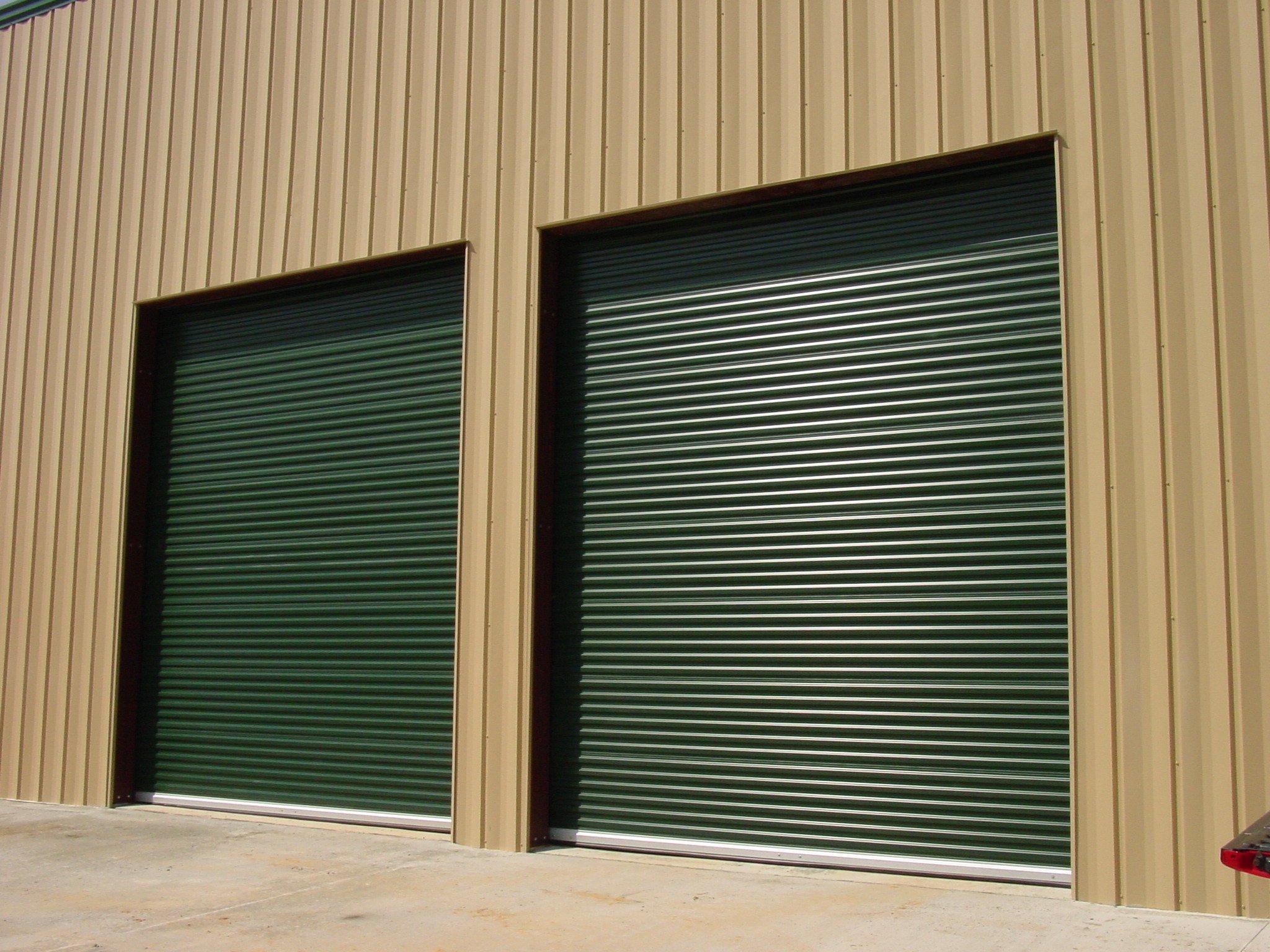Green Commercial Doors Installed on Metal Garage