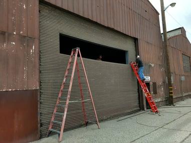 old commercial steel roll up door left side view