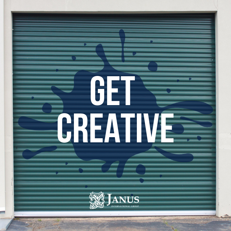 Roll-up green steel door with caption 'get creative' and janus branded logo