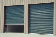 Green Janus International steel roll up doors model 2000