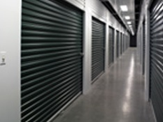Janus International interior metal hallway system with green steel roll up doors