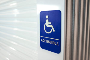 Janus International ADA accessible placard for self storage roll up doors