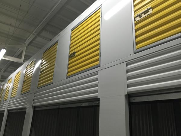 Yellow Janus International self storage lockers with interior hallway system