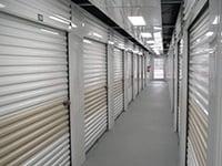 Hallway system of white Janus International doors