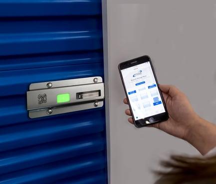 Noke ONE smart lock on self storage unit door using smartphone app to open
