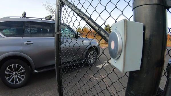 A car driving through a smart entry gate.