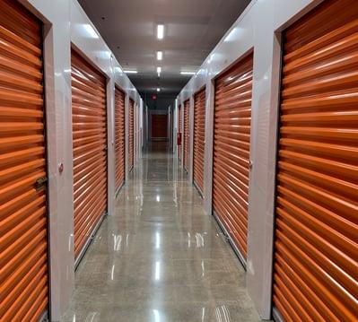 Janus orange self-storage doors with smart entry system