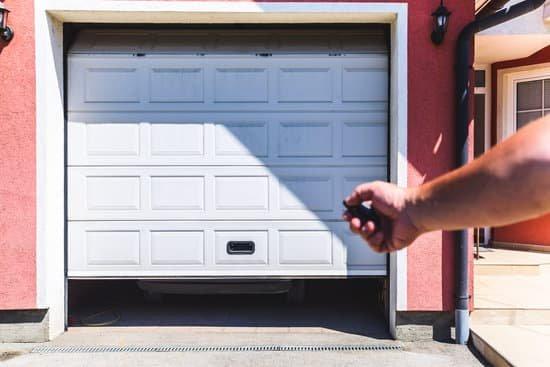 hand using remote to open garage door