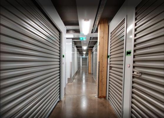 Hallway with grey storage units using electronic smart locks