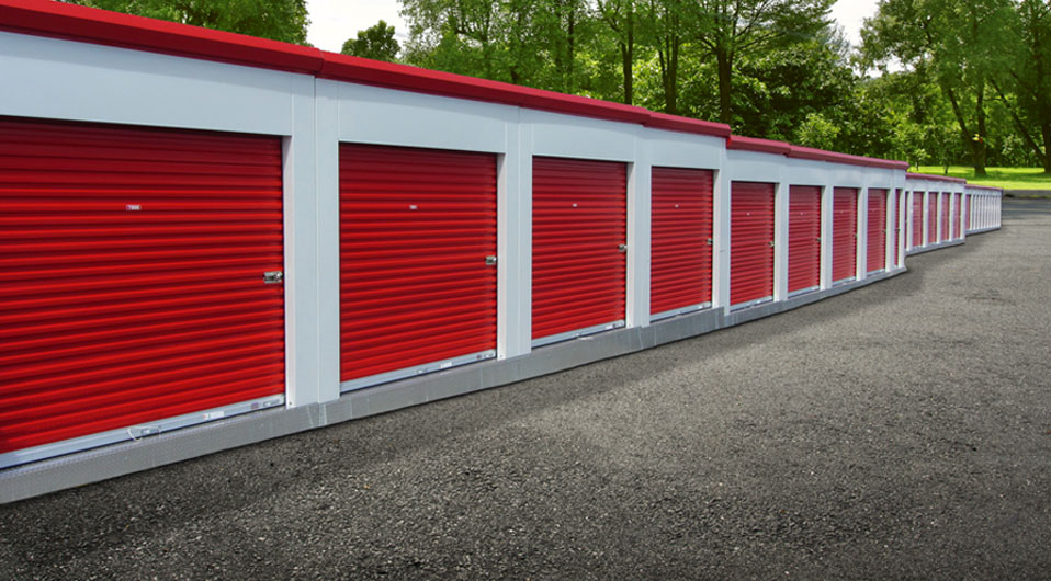 Image of portable storage unit buildings with red self storage doors