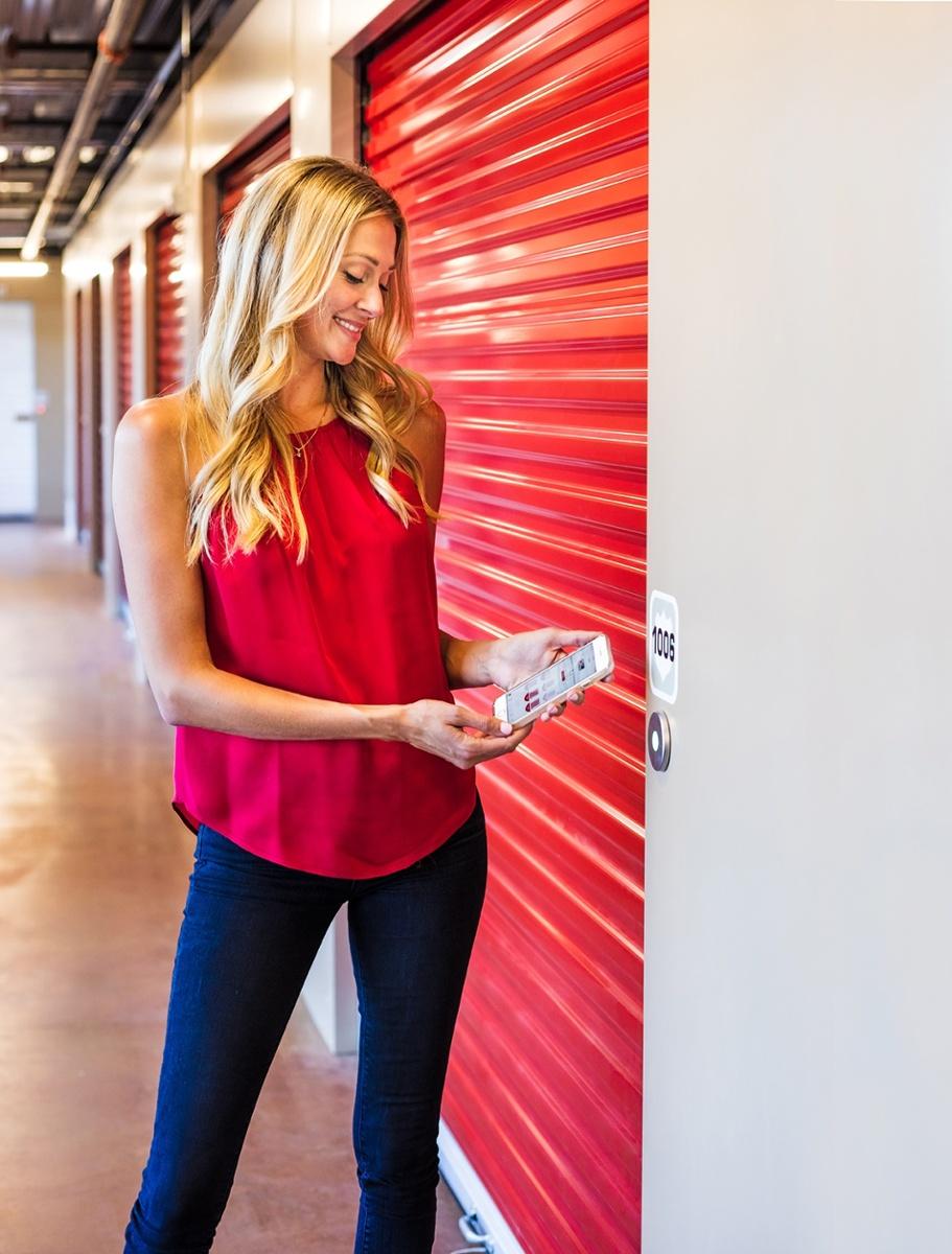 Girl using noke smart entry system on self storage unit