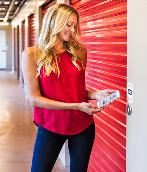 girl using Noke smart entry system on storage unit doors