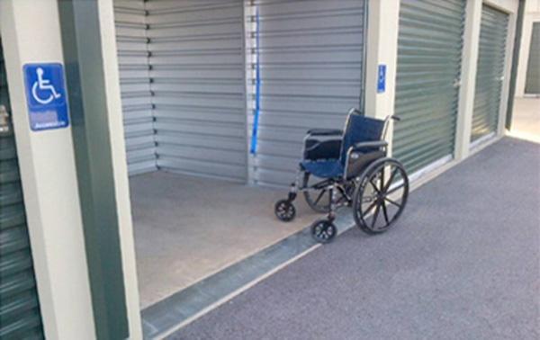 Wheelchair in front of ADA compliant self storage doors