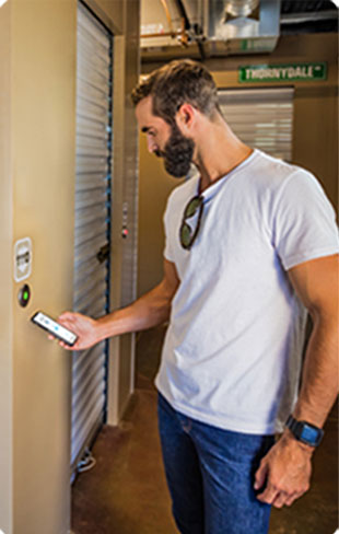 Man using noke smart entry system on storage unit door